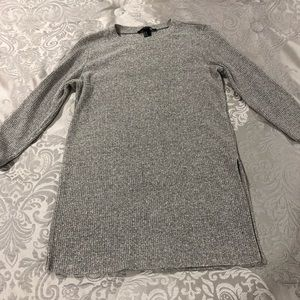 A long thin sweater